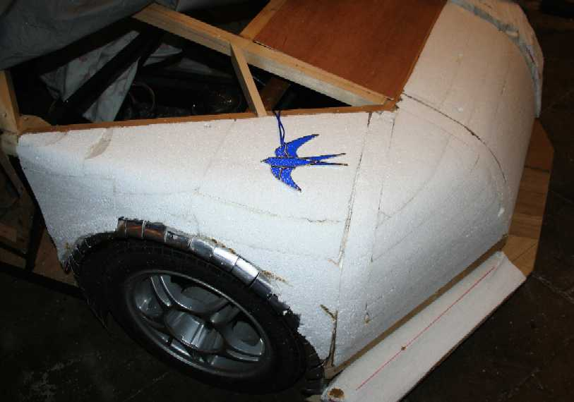 The drivers wing and a stained glass ornament blue bird