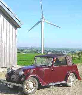 1936 electric Wilson with wind turbine in the background